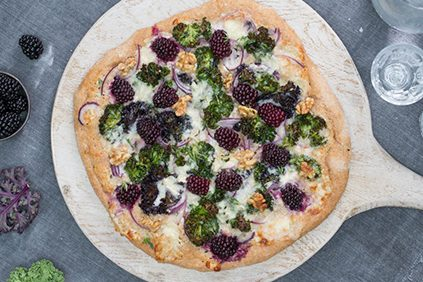 Spelt base pizza with blackberries, gorgonzola, kale and walnuts